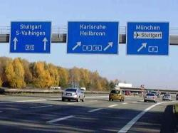 Exit signs at Autobahn crossing
